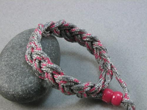 Childs rope bracelet in red and silver nylon - item 146