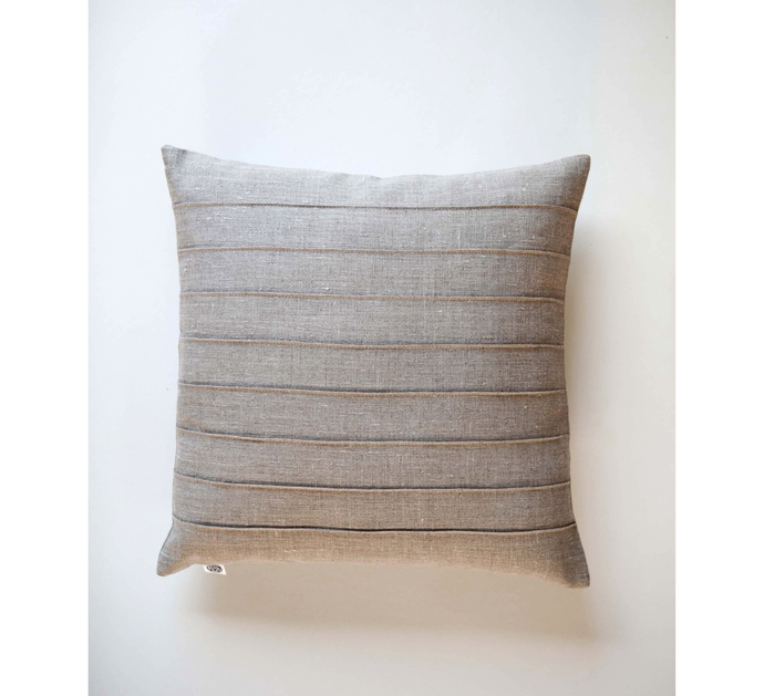 Linen throw pillow with decorative lines sewn. Custom size modern design, but
