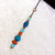 * SOLD * Zipper Pull or Charm with Blue and Wood color beads