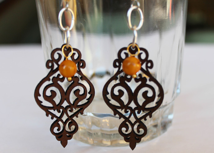 Yellow beaded earrings with laser cut brown leather, intricate scroll design