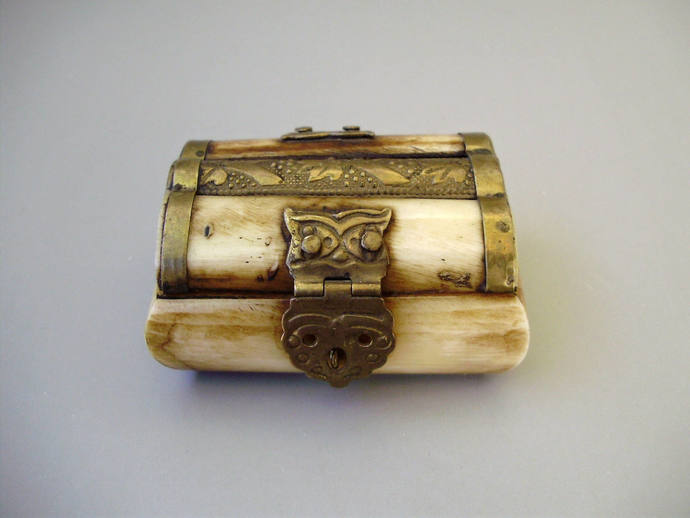 Vintage ink pot made of bone with copper