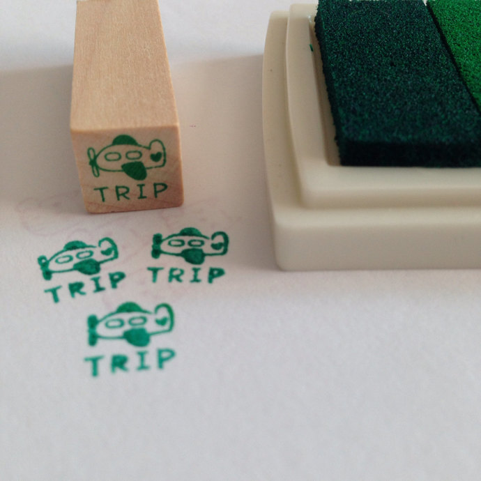 A mini Wooden Rubber Stamp: Trip by Plane