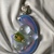118C Fused Dichroic Glass Moon Shaped Pendant in Pale Lavender, Orange & Gold