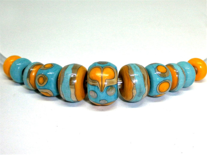 A Sari Silk Bead set in Glass, Turquoise and Yellow Lampwork Beads