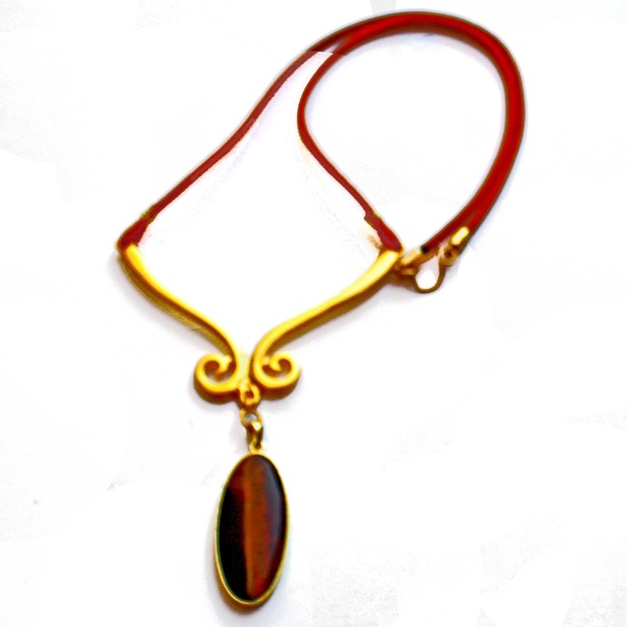 Beaded Necklace with a Large Brown Tiger Eye Pendant featured on an Ornate Brass
