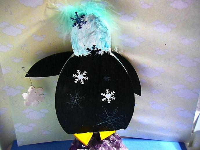 Patty Penguin- lover of poinsettia's and snowflakes