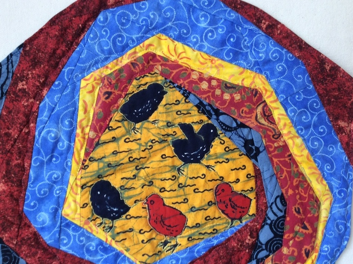 """Chicks in a Swirl, a small wallhanging or table mat 17""""x15"""""""