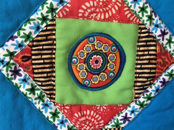 "Exuberant Star, a small wall quilt or table mat 18""x18"""