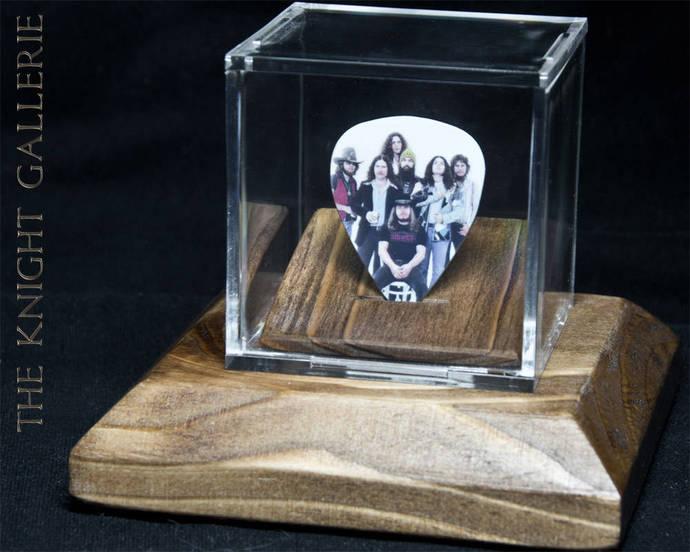 Lynyrd Skynyrd: commemorative guitar pick in a display case