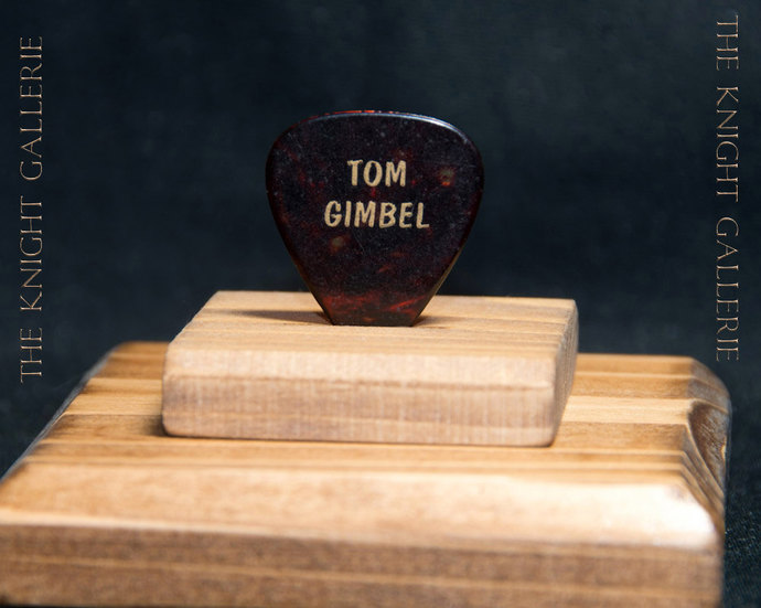FOREIGNER/TOM GIMBEL: authentic guitar pick and display ensemble