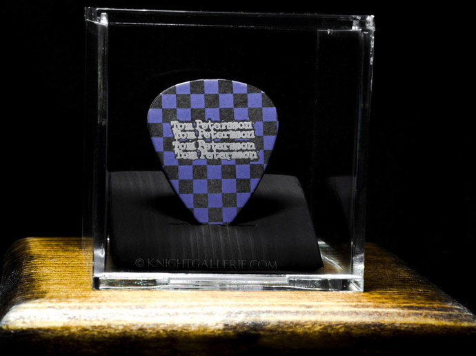 TOM PETERSSON (Cheap Trick):  guitar pick in a display case with stained wood