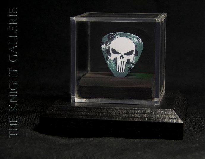 Skull Guitar pick in a display case