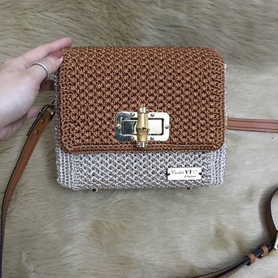 Elegant crochet bag with leather strap and handle