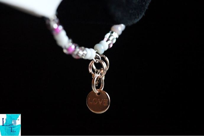 Pink and White seed beads on memory wire with Rose gold plated accessories