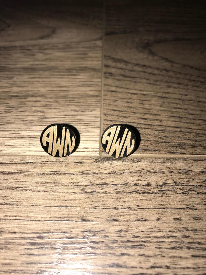 black studs with gold glitter monogrammed