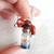 Sleeping fox on tiny bottle with sakura
