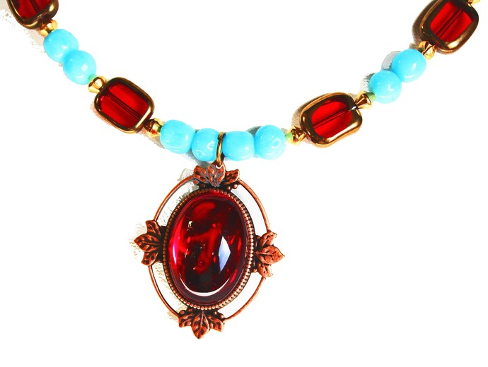 Beadednecklace features round Turquoise and rectangular Ruby Red beads, matching