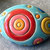 Stoneware Oval Bead with Red, Yellow and Blue Circle Design and two Light Blue