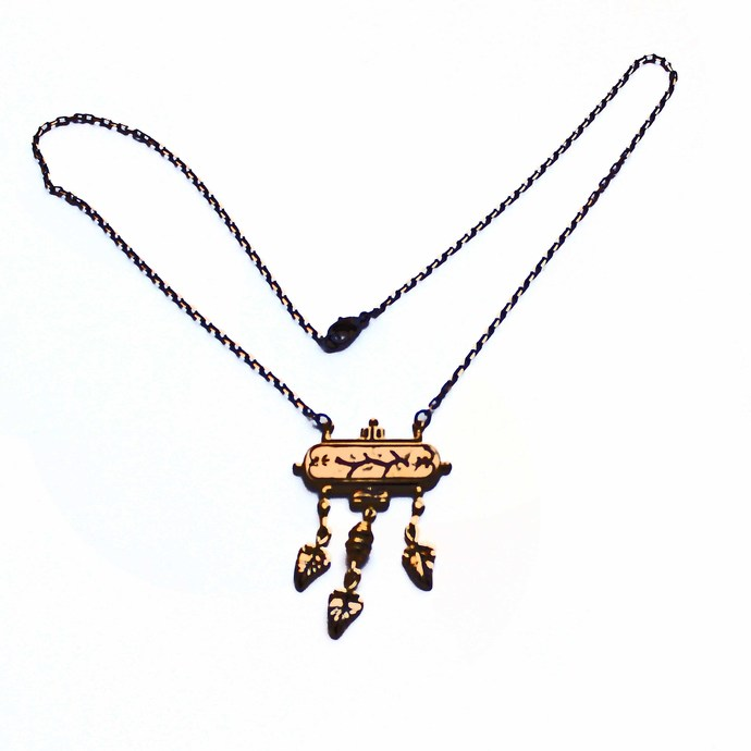 Petite brass necklace features a faceted link chain, with black accents, brass