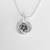 Silver pendant necklace, with a rose flower pendant encased in rings on a ball