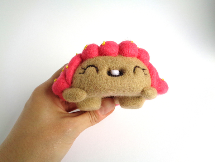 Donna, a pink frosted Donut girl Art toy, soft sculpture collectible toy