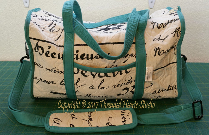 Turquoise, Cream and Black Travel Bag