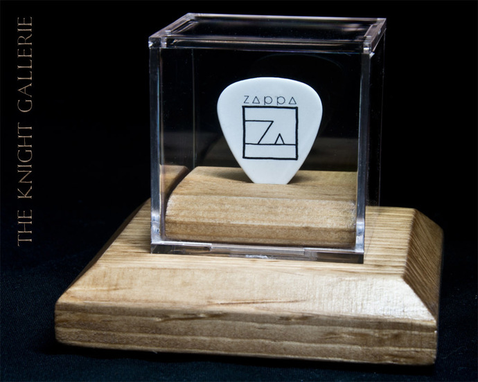 Commemorative guitar pick in a display case: Frank Zappa