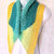 Shawlette crocheted in Lively Green and Yellow striped lightweight acrylic yarn