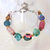 Bracelet beaded in Chunky Multicolored beads with bronze toggle clasp
