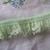 Gathered pastel green lace trim