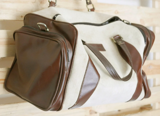 Travel bag vintage suitcase with handles in brown leather, lined inside
