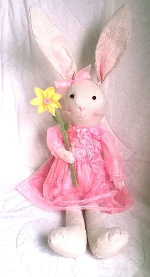 Adorable Stuffed Bunny wearing Pink Dress, Bow in Ear, Holding Sunflower