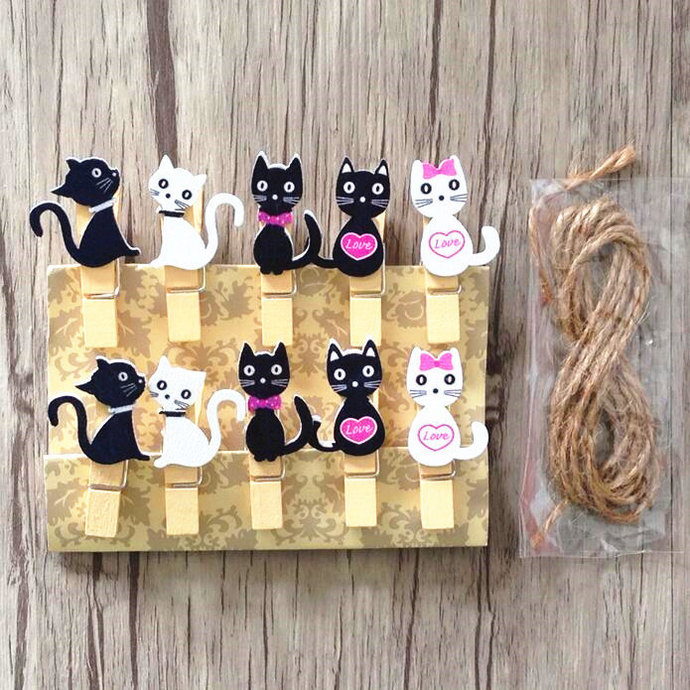 Wooden clips little white and black kittens