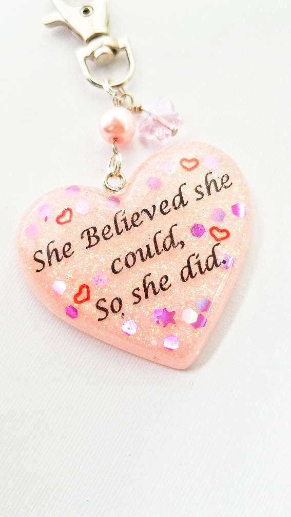 "Pastel pink ""she believed she could so she did"" resin heart keychain"