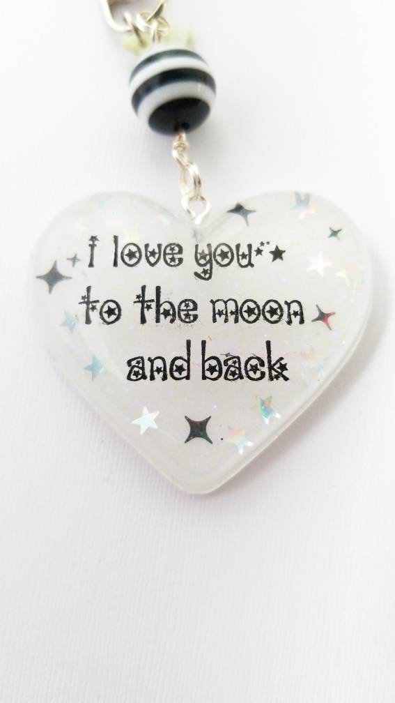 I love you to the moon and back black and white resin keychain