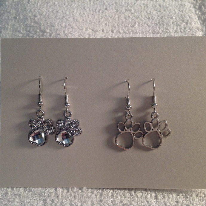 Silver paw print dangle earrings