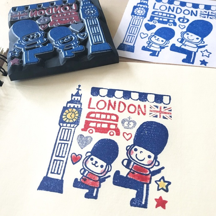 An exclusive Acha x London Gifties collaboration rubber stamp with wooden handle