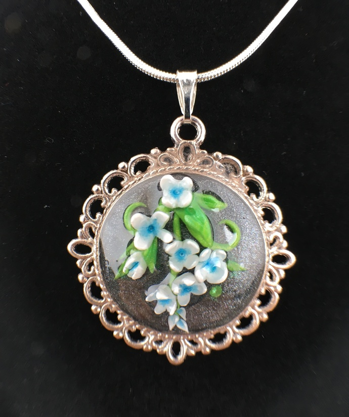White and blue flower pendant