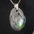 Marble pendant with silvery-black feathers