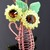 Beaded and wire woven sunflowers in vase pendant