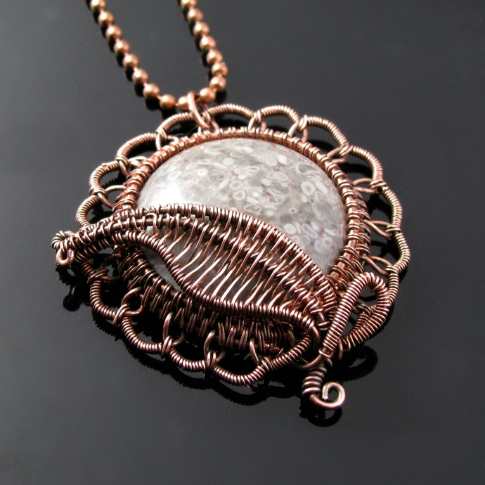 Wire woven flower pendant with crinoid cabochon
