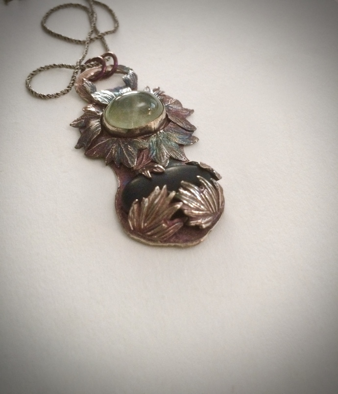 Prehnite gemstone, beach pebble, herb jewelry, rosemary leaves, oregano leaves,