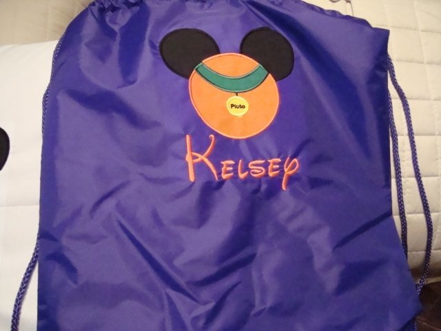 Pluto Mouse design along with an embroidered name of your choosing Cinch bag
