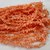 "20 strands Salmon/orange Coral chip beaded ,5-15 mm, 16"" long for making"