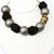 The large Wooden Beaded Necklace features round steel grey, black hexagonal