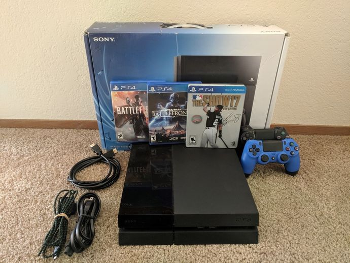 Sony PlayStation 4 - 500GB Console w/ 2 controllers and games