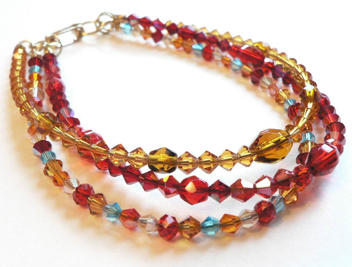 Red Amber Gold Blue Beaded Three Strand Bracelet