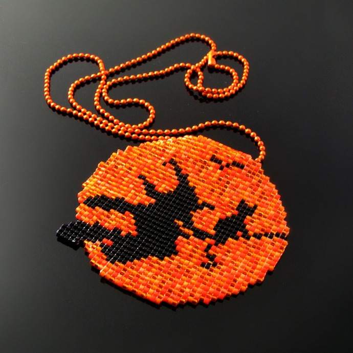 Flying witch and cat on broomstick in orange moon bead loomed pendant on ball