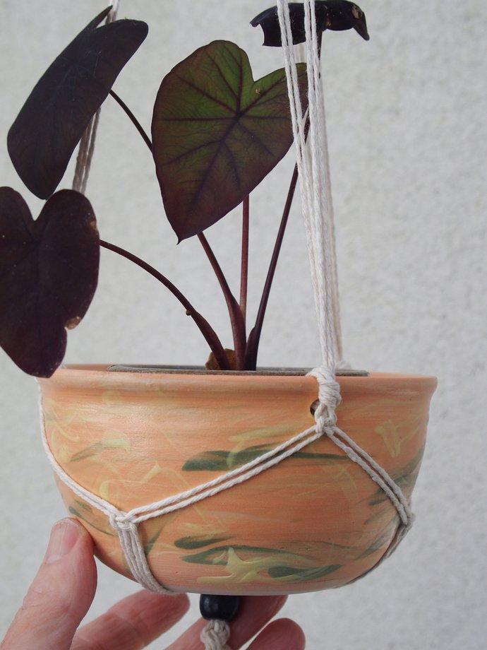 Wattle and bamboo hand painted, handmade ceramic hanging pot in handmade macrame