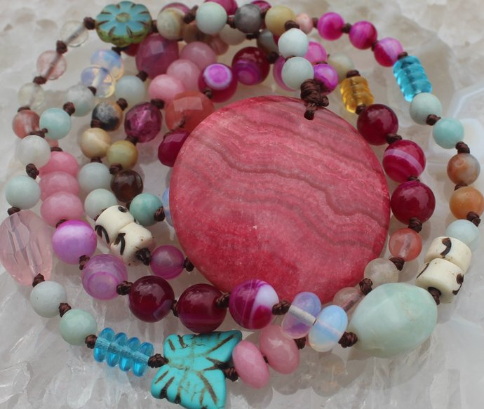 Out of the ordinary Long Beaded Necklace with Rhodochrosite Pendant Hand knot